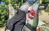 بوسه مادر مهرداد میناوند بر سنگ مزار پسرش